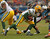 Aaron Rodgers #12 of the Green Bay Packers moves to avoid rushing members of the Chicago Bears at Soldier Field on December 16, 2012 in Chicago, Illinois. The Packers defeated the Bears 21-13. (Photo by Jonathan Daniel/Getty Images)