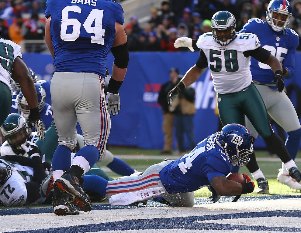 Description of . Ahmad Bradshaw #44 of the New York Giants scores a touchdown against the Philadelphia Eagles during their game against the at MetLife Stadium on December 30, 2012 in East Rutherford, New Jersey.  (Photo by Al Bello/Getty Images)