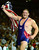 In this Sept. 27, 2000, file photo, USA's Rulon Gardner waves the American flag following his gold medal win against three-time Olympic gold medalist Alexandre Kareline, of Russia, in the Greco-Roman 130 kg final wrestling match at the Summer Games in Sydney. Gardner's epic upset of Russian wrestling great Alexander Karelin in 2000 remains one of the most compelling moments of the modern Olympics. Starting in 2020, youngsters looking to Gardner and Karelin for inspiration won't have a chance to excel on the sport's biggest stage. Gardner and nearly everyone else associated with the sport in the U.S. were jolted Tuesday, Feb. 12, 2013 when International Olympic Committee leaders dropped wrestling from the Summer Games. (AP Photo/Katsumi Kasahara, File)