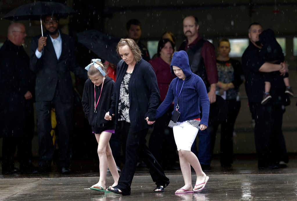 Description of . Mourners leave a funeral service for Antonia Calendaria, 9, a student at Towers Plaza Elementary school who was killed by Monday's tornado Thursday, May 23, 2013, in Oklahoma City, Oklahoma. (AP Photo/Tony Gutierrez)