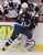WINNIPEG, MB - JANUARY 19:  Grant Clitsome #24 of the Winnipeg Jets takes Jim O'Brien #18 of the Ottawa Senators to the boards during period action on January 19, 2013 at the MTS Centre in Winnipeg, Manitoba, Canada. (Photo by Marianne Helm/Getty Images)