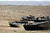 Israeli reserve soldiers sit atop tanks as they manoeuvre during a drill at a military zone near Kibbutz Revivim in southern Israel March 7, 2013. Wary of flare-ups with Iran and Syria, Israel is preparing to take on Hezbollah, their militia vanguard in neighbouring Lebanon, and warning Beirut of the steep price of any such war. REUTERS/Amir Cohen