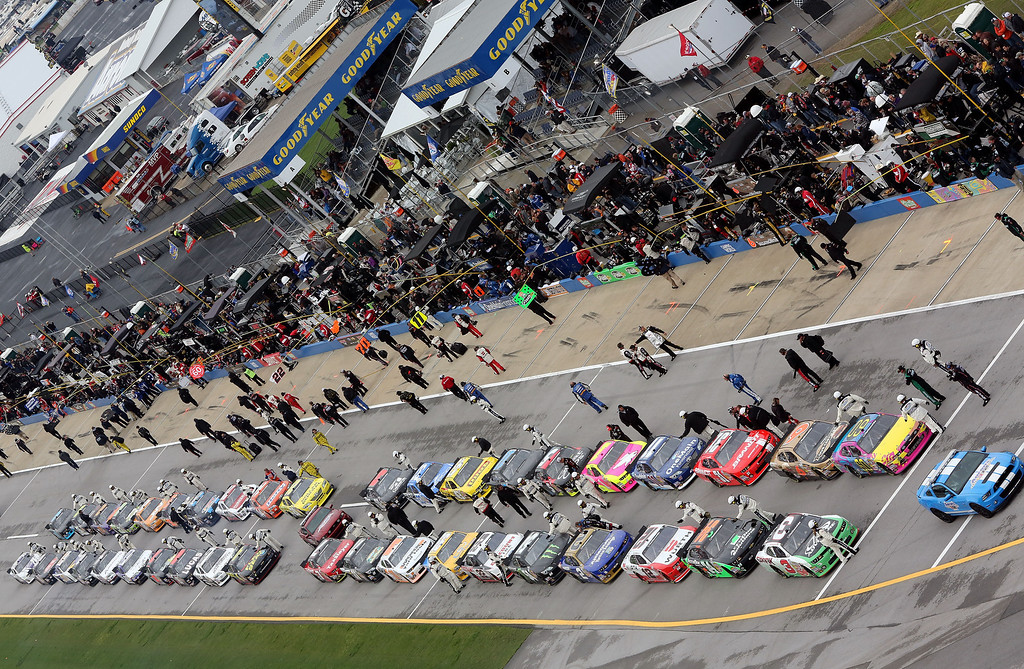 Description of . TALLADEGA, AL - MAY 04:  Cars line up on pit road prior to the start of the NASCAR Nationwide Series Aaron's 312 at Talladega Superspeedway on May 4, 2013 in Talladega, Alabama.  (Photo by Jerry Markland/Getty Images)
