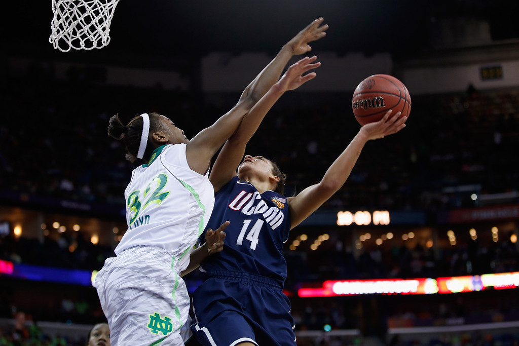 Description of . NEW ORLEANS, LA - APRIL 07:  Bria Hartley #14 of the Connecticut Huskies shoots the ball over Jewell Loyd #32 of the Notre Dame Fighting Irish during the National Semifinal game of the 2013 NCAA Division I Women\'s Basketball Championship at the New Orleans Arena on April 7, 2013 in New Orleans, Louisiana.  (Photo by Chris Graythen/Getty Images)