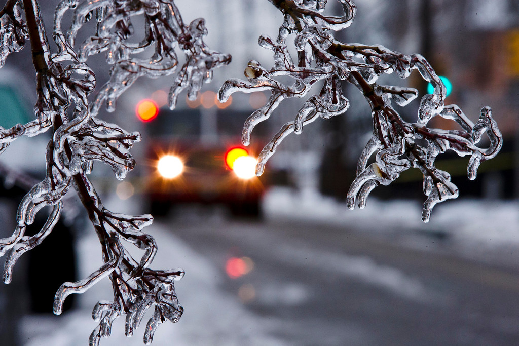 Description of . An ice covered tree limb that took out a utility line blocks the path of a firetruck after a winter storm Wednesday, Feb. 5, 2014, in Philadelphia.  I  (AP Photo/Matt Rourke)