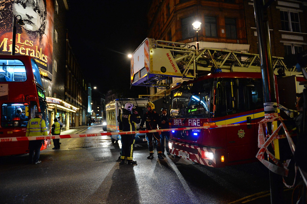 . Emergency services personnel assemble behind a cordon following a ceiling collapse at a theatre in Central London on December 19, 2013.    AFP PHOTO/LEON NEAL/AFP/Getty Images
