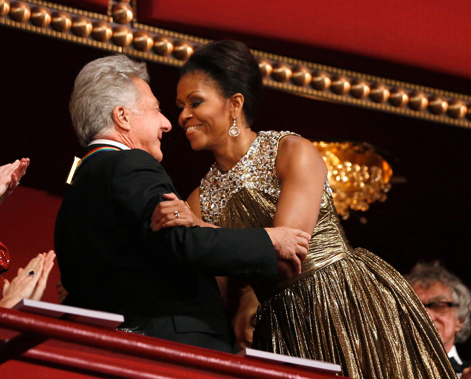 Description of . U.S. first lady Michelle Obama (R) embraces 2012 Kennedy Center honoree, actor Dustin Hoffman at the Kennedy Center in Washington, December 2, 2012.     REUTERS/Jason Reed