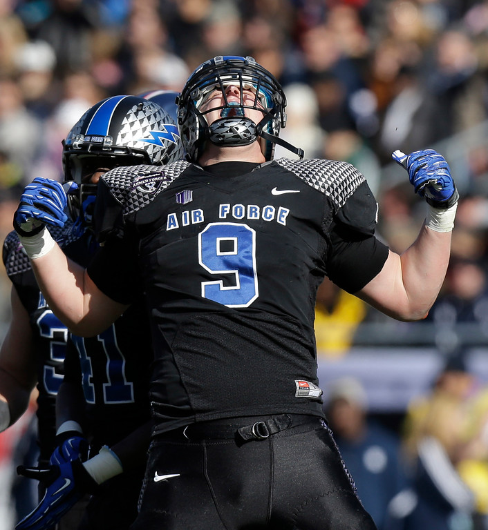 Description of . Air Force linebacker Alex Means (9) celebrates a sack against the Rice during the first half of the Armed Forces Bowl NCAA college football game Saturday, Dec. 29, 2012, in Fort Worth, Texas. (AP Photo/LM Otero)