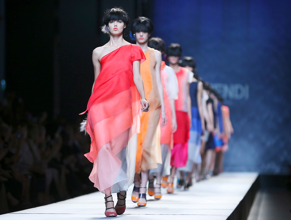 Description of . Models wear creations for Fendi  women's Spring-Summer 2014 collection, part of the Milan Fashion Week, unveiled in Milan, Italy, Thursday, Sept. 19, 2013. (AP Photo/Antonio Calanni)