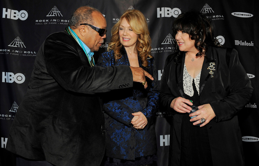 Description of . 2013 Rock and Roll Hall of Fame inductee Quincy Jones, left, mingles with fellow inductees Nancy Wilson, center, and her sister Ann of the band Heart following a news conference to announce the 2013 inductees, Tuesday, Dec. 11, 2012, in Los Angeles. The 28th Annual Rock and Roll Hall of Fame Induction Ceremony will be held at the Nokia Theatre L.A. Live in Los Angeles on April 18, 2013. (Photo by Chris Pizzello/Invision/AP)