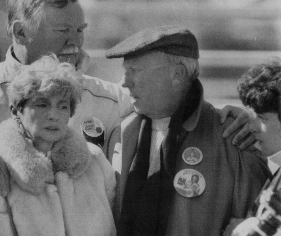 Description of . An unidentified man consoles the parents of astronaut-teacher, Christa McAuliffe after she and 6 other astronauts were presumed killed in an explosion that ripped apart Space Shuttle orbiter Challenger shortly after liftoff on Jan. 28, 1986. Denver Post Library Archive