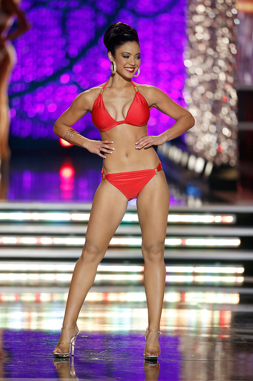 Description of . Miss Iowa Mariah Cary competes in the swimsuit portion of the Miss America 2013 pageant on Saturday, Jan. 12, 2013, in Las Vegas. (AP Photo/Isaac Brekken)