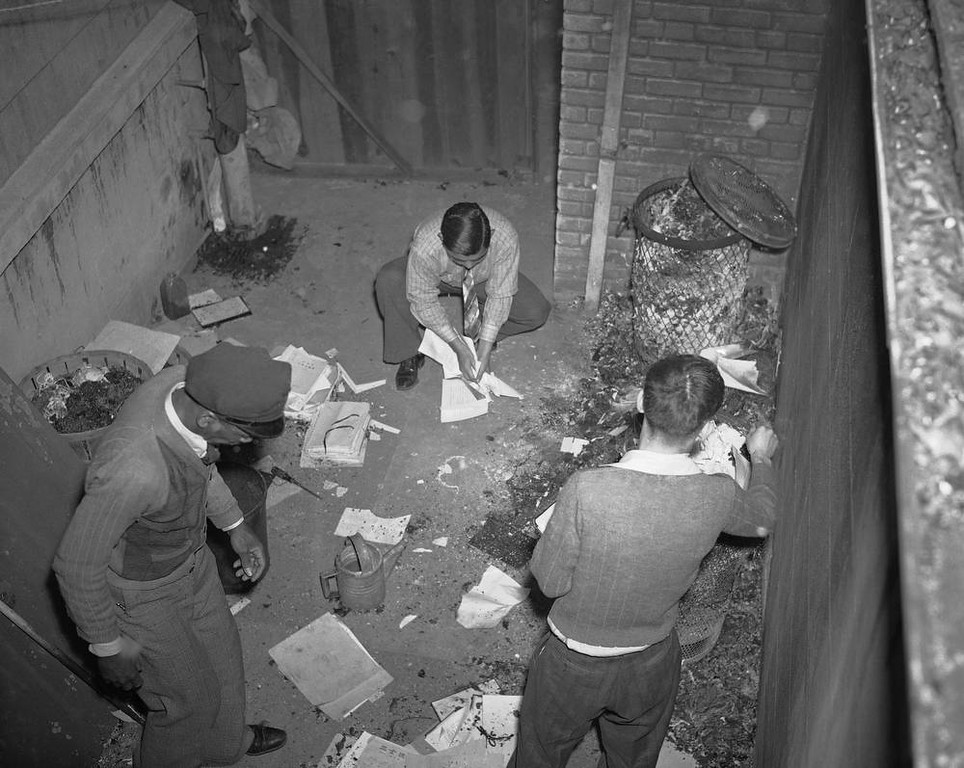 Description of . Unidentified attaches of the Japanese consulate began burning papers, ledgers and other records shortly after Japan went to war against the U.S., Dec. 7, 1941, in New Orleans.  Police later stopped the fire after most of the papers had been destroyed.  (AP Photo/Horace Cort)