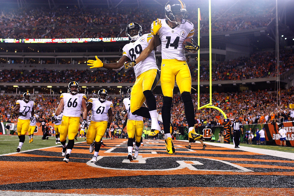 Description of . Jerricho Cotchery #89 and Derek Moye #14 of the Pittsburgh Steelers celebrate after scoring a touchdown during the second quarter against the Cincinnati Bengals on September 16, 2013 at Paul Brown Stadium on September 16, 2013 in Cincinnati, Ohio. (Photo by Kirk Irwin/Getty Images)