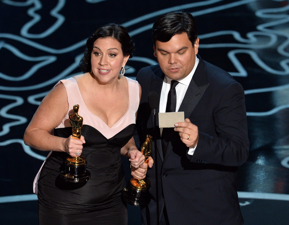 Description of . Songwriters Kristen Anderson-Lopez (L) and Robert Lopez accept the Best Achievement in Music Written for Motion Pictures, Original Song award for 'Let It Go' from 'Frozen' onstage during the Oscars at the Dolby Theatre on March 2, 2014 in Hollywood, California.  (Photo by Kevin Winter/Getty Images)