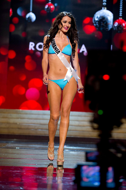 Description of . Miss Romania Delia Monica Duca competes in her Kooey Australia swimwear and Chinese Laundry shoes during the Swimsuit Competition of the 2012 Miss Universe Presentation Show at PH Live in Las Vegas, Nevada December 13, 2012. The 89 Miss Universe Contestants will compete for the Diamond Nexus Crown on December 19, 2012. REUTERS/Darren Decker/Miss Universe Organization/Handout