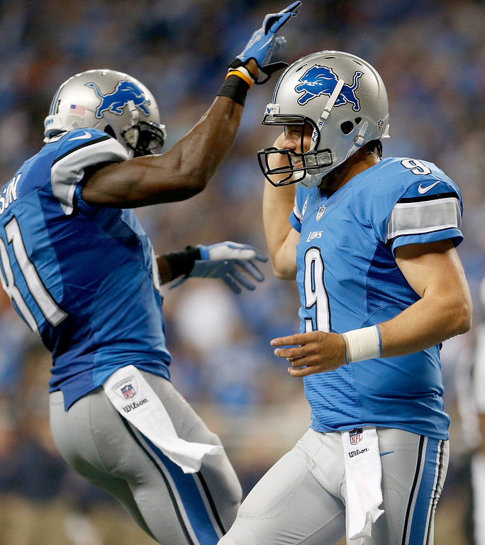 Description of . DETROIT, MI - SEPTEMBER 29:  Calvin Johnson #81 and Matthew Stafford #9 of the Detroit Lions celebrate a touchdown against the Chicago Bears at Ford Field on September 29, 2013 in Detroit, Michigan. (Photo by Gregory Shamus/Getty Images)