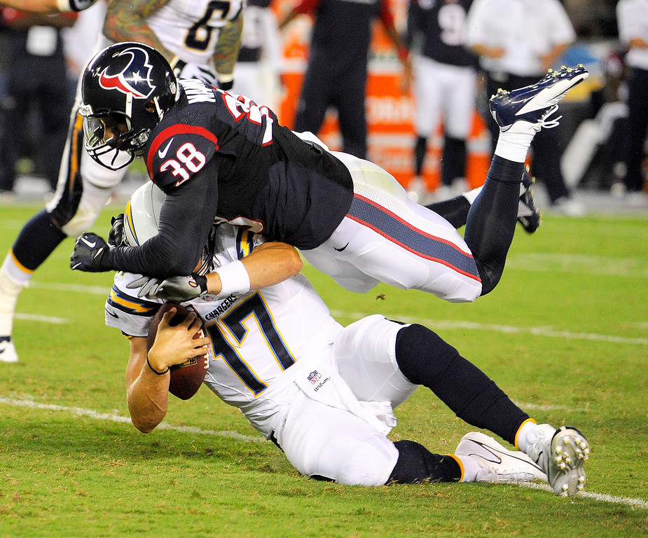 Description of . Houston Texans free safety Danieal Manning, top, sacks San Diego Chargers quarterback Philip Rivers during the first half of an NFL football game Monday, Sept. 9, 2013, in San Diego. (AP Photo/Denis Poroy)