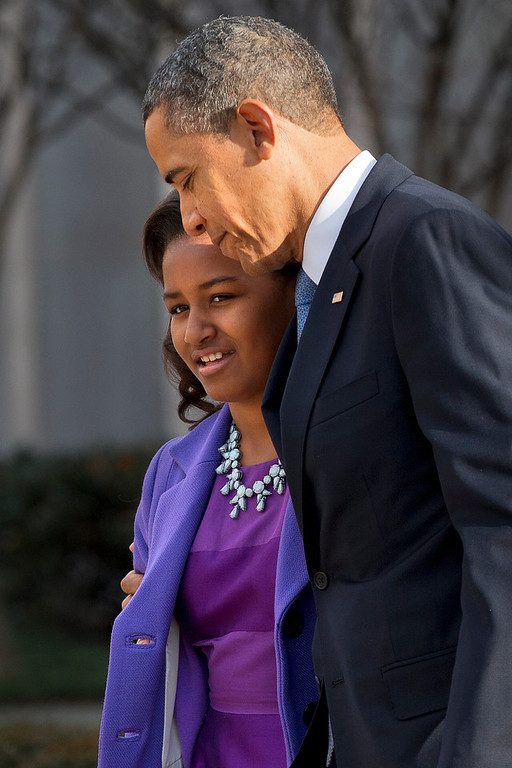 Description of . President Barack Obama walks with daughter Sasha as they leave St. John\'s Church in Washington, Monday, Jan. 21, 2013, after attending a church service during the 57th Presidential Inauguration. (AP Photo/Jacquelyn Martin)