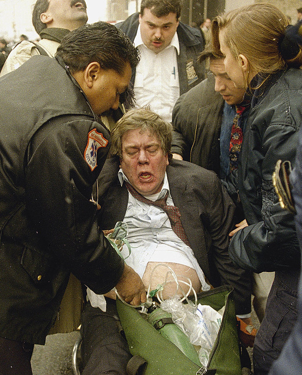 Description of . An injured man is aided by rescue workers after an explosion rocked the World Trade Center in New York, Feb. 26, 1993. (AP Photo/Joe Tabacca)