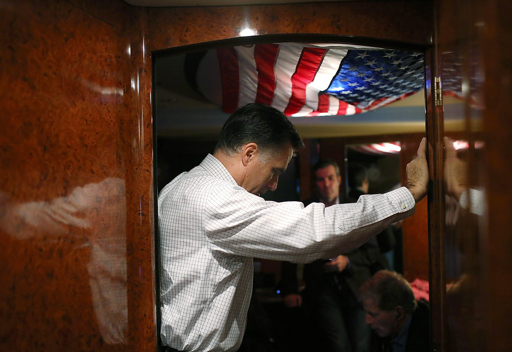 Description of . Republican presidential candidate, former Massachusetts Gov. Mitt Romney listens in on conference call with advisors aboard his campaign bus en route to a campaign rally at Avon Lake High School on October 29, 2012 in Avon Lake, Ohio. Romney has canceled other campaign events on October 29 and 30 due to Hurricane Sandy.  (Photo by Justin Sullivan/Getty Images)