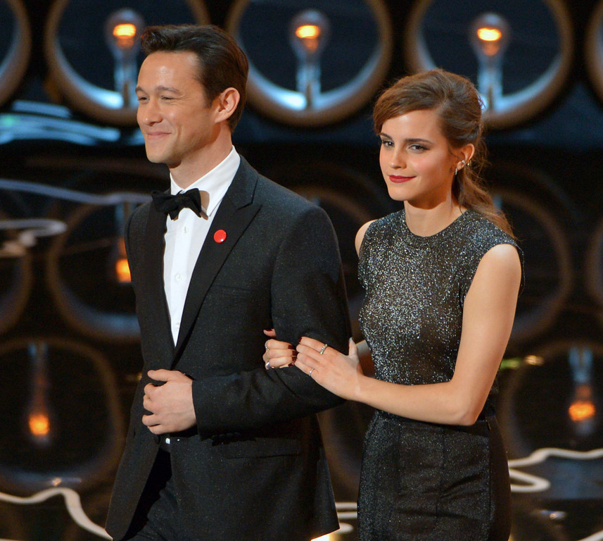 Description of . Presenters Joseph Gordon-Levitt, left, and Emma Watson walk on stage during the Oscars at the Dolby Theatre on Sunday, March 2, 2014, in Los Angeles.  (Photo by John Shearer/Invision/AP)