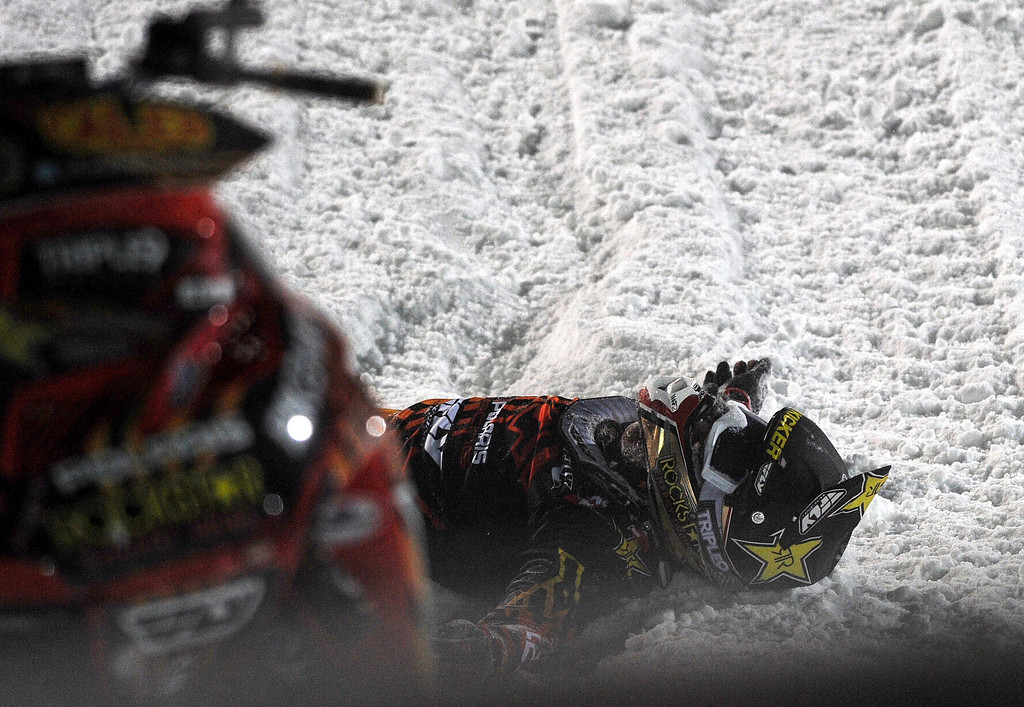 Description of . In this photo taken Jan. 24, 2013, Caleb Moore lies in the snow after he crashed during the snowmobile freestyle event at the Winter X Games in Aspen, Colo. (AP Photo/The Colorado Springs Gazette, Christian Murdock) MAGS OUT