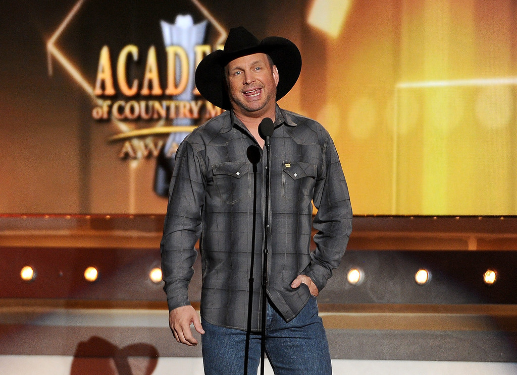 Description of . Garth Brooks speaks on stage at the 49th annual Academy of Country Music Awards at the MGM Grand Garden Arena on Sunday, April 6, 2014, in Las Vegas. (Photo by Chris Pizzello/Invision/AP)