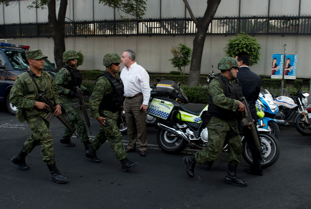 Description of . Soldiers arrive on the premises of the skyscraper that houses the headquarters of state-owned Mexican oil giant Pemex in Mexico City on January 31, 2013, following a blast inside the building.   YURI CORTEZ/AFP/Getty Images