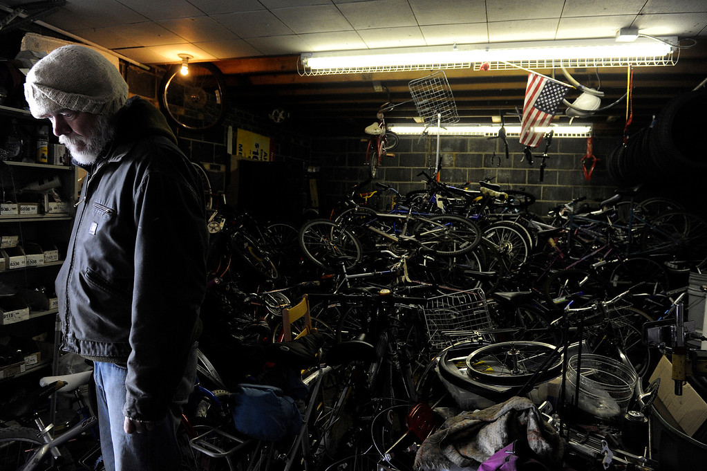 Description of . AURORA, CO - NOVEMBER 21: Howard Jarrett surveys the Second Chance Bicycle Shop on November 21, 2013, in Aurora, Colorado. Housed in the Aurora Warms the Night garage, the shop provides homeless clients with an outlet to learn a skill and apply it to help others. A client must work in the shop for six weeks before he or she can take a fixed-up bicycle away with them. Jarrett has been working in the shop for several years, and says it helped him along his path to recovery. (Photo by Anya Semenoff/YourHub)