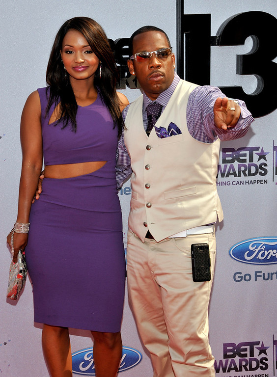 Description of . Bobby Brown, right, arrives at the BET Awards at the Nokia Theatre on Sunday, June 30, 2013, in Los Angeles. (Photo by Chris Pizzello/Invision/AP)