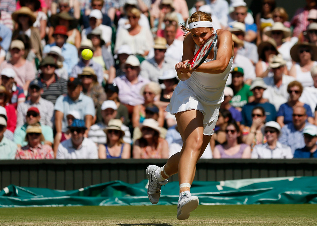Description of . Sabine Lisicki of Germany returns to Marion Bartoli of France during their Women's singles final match at the All England Lawn Tennis Championships in Wimbledon, London, Saturday, July 6, 2013.  (AP Photo/Stefan Wermuth, Pool)