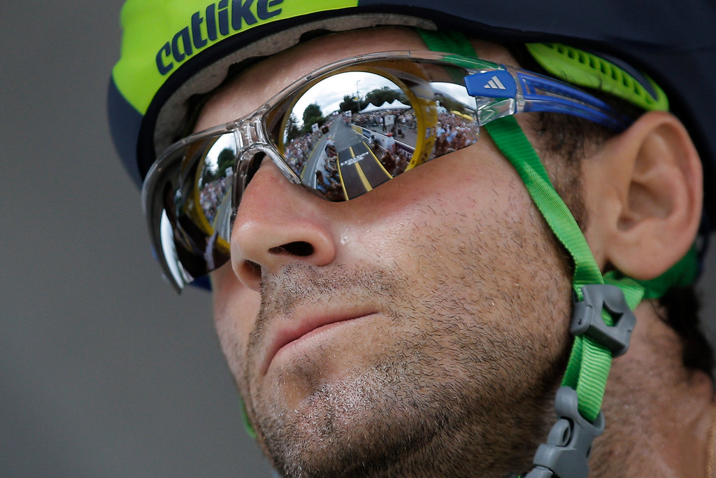 Description of . Spain's Alejandro Valverde concentrates prior to the start of the seventeenth stage of the Tour de France cycling race an individual time trial over 32 kilometers (20 miles) with start in Embrun and finish in Chorges, France, Wednesday July 17, 2013. (AP Photo/Christophe Ena)