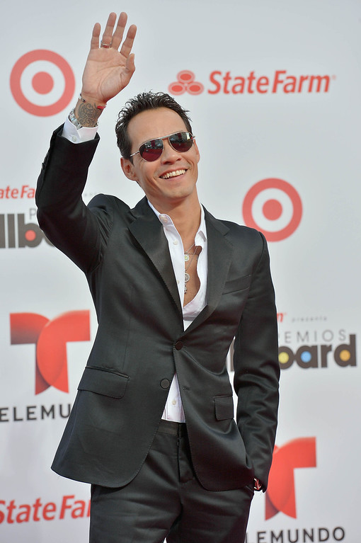 Description of . MIAMI, FL - APRIL 25:  Marc Anthony arrives at Billboard Latin Music Awards 2013 at Bank United Center on April 25, 2013 in Miami, Florida.  (Photo by Gustavo Caballero/Getty Images)