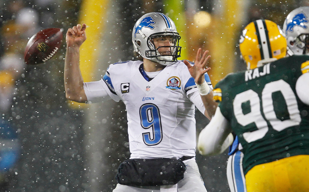 Description of . Detroit Lions quarterback Matthew Stafford fumbles the ball during the first half of an NFL football game against the Green Bay Packers Sunday, Dec. 9, 2012, in Green Bay, Wis. Green Bay Packers' Mike Daniels recovered the fumble and ran it back 43 yards for a touchdown. (AP Photo/Mike Roemer)