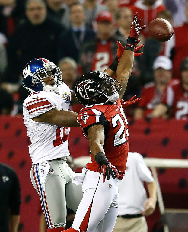 Description of . Dominique Franks #29 of the Atlanta Falcons breaks up a pass intended for Jerrel Jernigan #12 of the New York Giants at Georgia Dome on December 16, 2012 in Atlanta, Georgia.  (Photo by Kevin C. Cox/Getty Images)