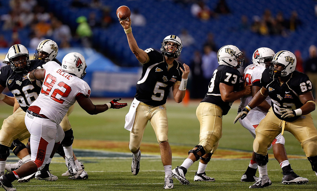 Description of . Quarterback Blake Bortles #5 of the Central Florida Knights throws a pass against the Ball State Cardinals during the Beef 'O' Brady's St Petersburg Bowl Game at Tropicana Field on December 21, 2012 in St Petersburg, Florida.  (Photo by J. Meric/Getty Images)