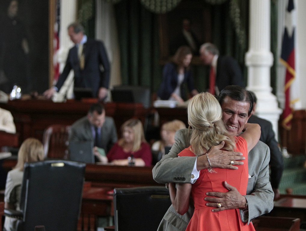 Description of . Texas Sen. Wendy Davis (D-Ft. Worth) is hugged by Texas Sen. Eddie Lucio (D-Brownsville) on the Texas Senate floor on the first day of the second legislative special session on July 1, 2013 in Austin, Texas. This is the first day of a second legislative special session called by Texas Gov. Rick Perry to pass a restrictive abortion law through the Texas legislature. The first attempt was defeated after opponents of the law were able to stall the vote until after first special session had ended.  (Photo by Erich Schlegel/Getty Images)