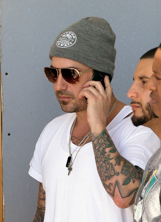 . Jeremy Bieber, the father of Justin Bieber,  talks on his phone outside of the Turner Guilford Knight Correctional Center, Thursday, Jan. 23, 2014, in Miami. Justin Bieber was arrested and charged with driving under the influence and resisting arrest after police said they saw him speeding down a residential street in Miami Beach in a yellow Lamborghini earlier in the day. (AP Photo/Wilfredo Lee)
