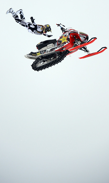 Description of . ASPEN, CO. - JANUARY 24:  Colten Moore practices for Snowmobile Freestyle, January 24, 2013,during the 2013. Winter X Games in Aspen. Colten will compete, along with his brother Caleb Moore, in the Snowmobile Freestyle Finals. (Photo By RJ Sangosti / The Denver Post)