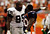 (hc) Broncos vs. Raiders-- Oakland Raiders DT Warren Sapp, left, is talking with Denver Broncos RB Travis Henry during 4th quarter of the game at Invesco Field at Mile High on Sunday. Hyoung Chang/ The Denver Post
