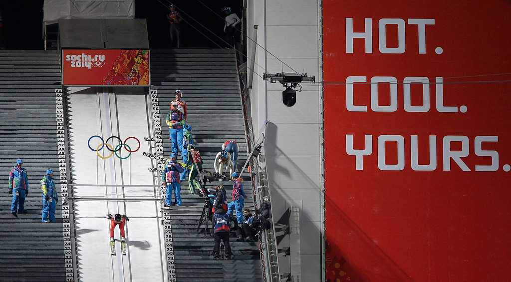 Description of . United States' Peter Frenette starts an attempt during the ski jumping large hill team competition at the 2014 Winter Olympics, Monday, Feb. 17, 2014, in Krasnaya Polyana, Russia. (AP Photo/Matthias Schrader)