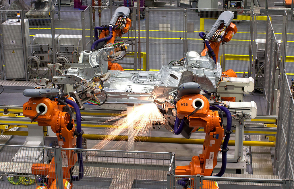 . Robots ready to produce the new Mini Cooper are pictured during a tour of the BMW\'s plant at Cowley in Oxford, central England, on November 18, 2013. Car giant BMW, which has been manufacturing the Mini since 2001, has finally taken the wraps off the  new Mini that will be available in the UK in Spring 2014. ANDREW COWIE/AFP/Getty Images