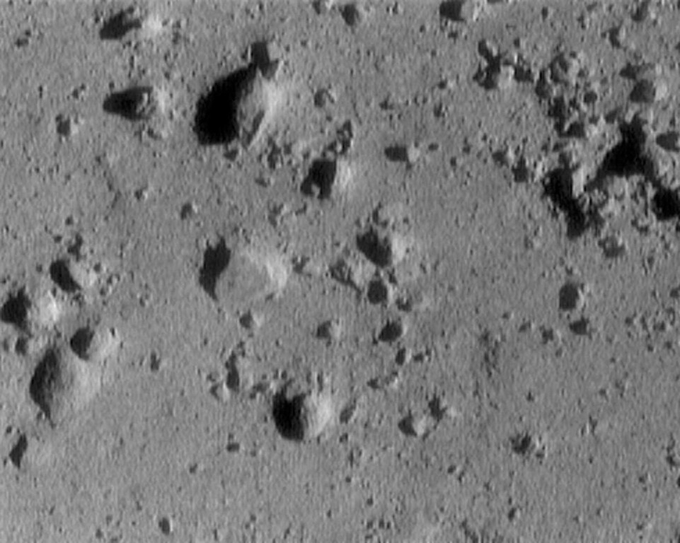 Description of . This photo released by NASA Monday, Feb. 12, 2001, was taken by the NEAR spacecraft as it descended toward the barren, rocky, surface of the asteroid Eros. It was taken from 820 feet above the asteroid's surface. The image is 12 meters (39 feet) across. The cluster of rocks at the upper right measures 1.4 meters (5 feet) across. (AP Photo/HO, Johns Hopkins University Applied Physics Labratory)