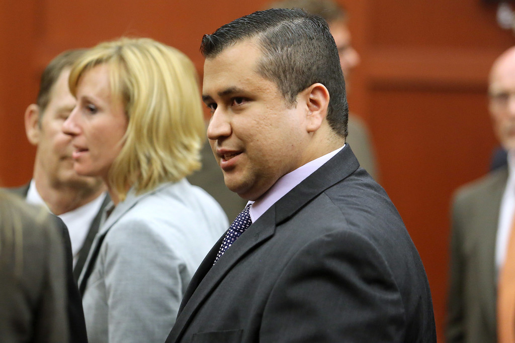Description of . SANFORD, FL - JULY 13:  George Zimmerman leaves the courtroom a free man after being found not guilty, on the 25th day of his trial at the Seminole County Criminal Justice Center July 13, 2013 in Sanford, Florida. Zimmerman was charged with second-degree murder in the 2012 shooting death of Trayvon Martin.  (Photo by Joe Burbank-Pool/Getty Images)