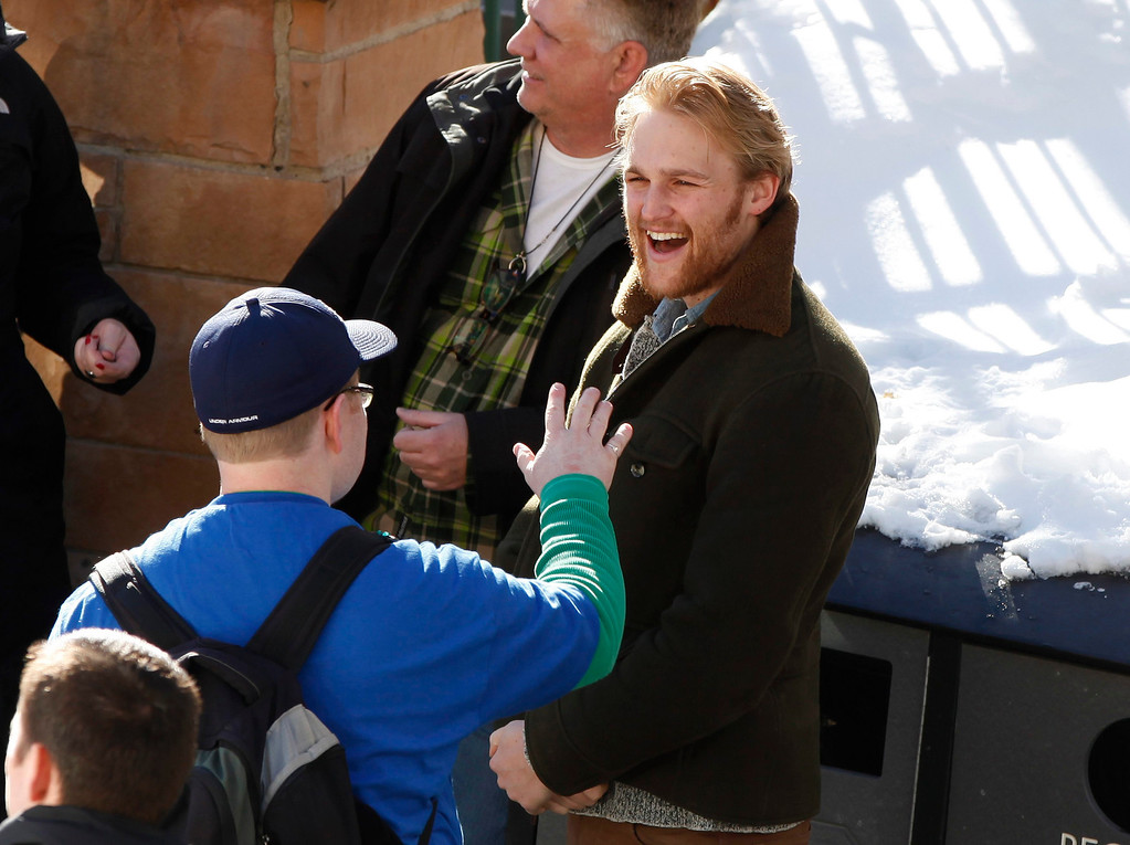 Description of . Actor Wyatt Russell talks to people along Main Street during the Sundance Film Festival in Park City, Utah, January 18, 2013.  REUTERS/Jim Urquhart