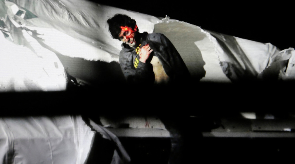 Description of . In this Friday, April 19, 2013 Massachusetts State Police photo, 19-year-old Boston Marathon bombing suspect Dzhokhar Tsarnaev leans over in a boat at the time of his capture by law enforcement authorities in Watertown, Mass.   (AP Photo/Massachusetts State Police, Sean Murphy)