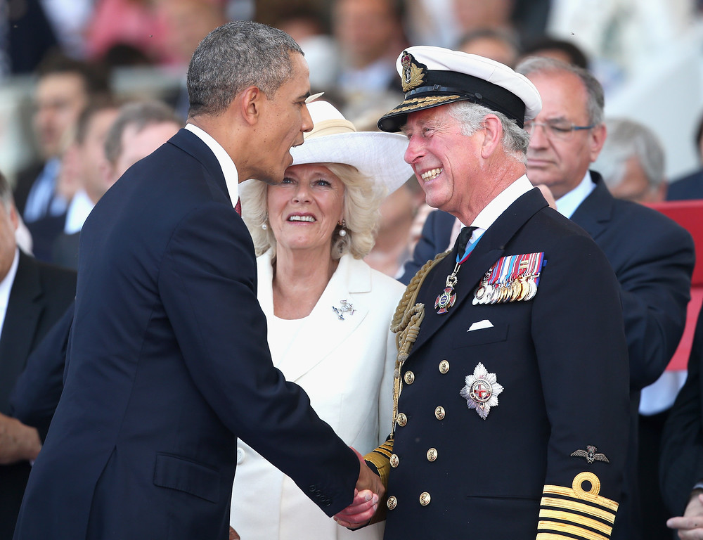 Description of . Prince Charles, Prince of Wales and Camilla, Duchess of Cornwall meet President Barak Obama of the United States during a Ceremony to Commemorate D-Day 70 on Sword Beach on June 6, 2014 in Ouistreham, France.  (Photo by Chris Jackson/Getty Images)