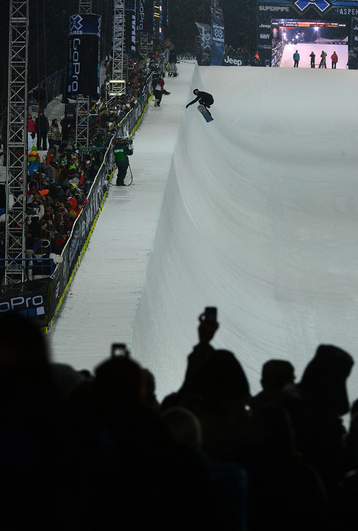 Description of . ASPEN, CO. - JANUARY 24:  Shaun White catches big air during the Snowboard SuperPipe Men's Eliminations, January 24, 2013, at the 2013 Winter X Games  at Buttermilk Mountain in Aspen. (Photo By RJ Sangosti / The Denver Post)