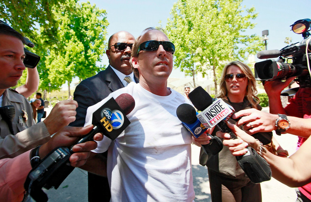 Description of . In this April 27, 2011 file photo, one of Paris Hilton's bodyguards, rear, escorts an unidentified assailant after the man grabbed Paris Hilton boyfriend Cy Waits while Waits and Hilton were walking into court  in Los Angeles. Hilton and her then-boyfriend Waits were accosted by James Rainford while they walked in to a courthouse to testify against another man who had broken in to the hotel heiress' Hollywood Hills home. Hilton's security wrestled Rainford to the ground and he was promptly arrested him and he pleaded no contest to misdemeanor battery. Rainford, who was repeatedly arrested outside Hilton's residences and asked her to marry him, was ultimately charged with felony stalking and sentenced to probation and psychiatric counseling in April 2012.  (AP Photo/Nick Ut, file)